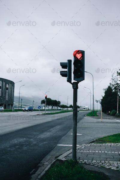 Traffic light in grey street with heart light