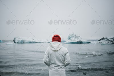 Tourist watch glacier in water in iceland