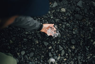 Person holds piece of glacier ice in iceland