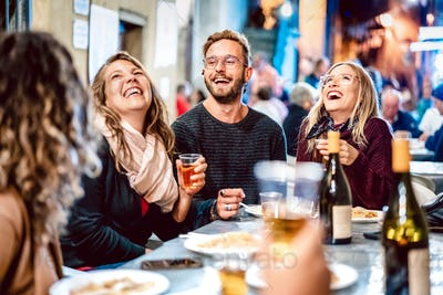 Happy friends having fun drinking white wine at street food festival