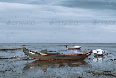 An old long fishing boat, riverside