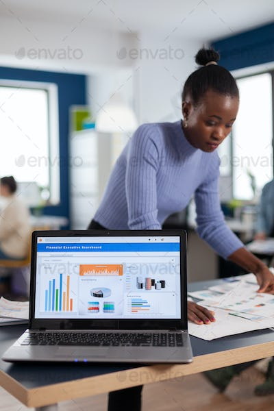 Laptop with financial charts on office of start up company