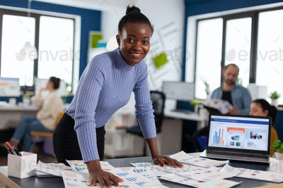 Portrait of black woman african manager entrepreneur smiling at camera