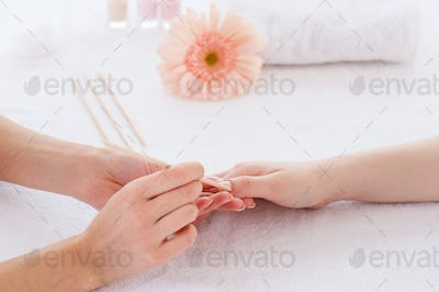 Nails cleaning. Close-up of beautician cleaning nails of female customer