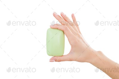 Soap bar. Close-up of woman holding soap bar while isolated on white