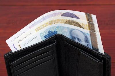 Norwegian krone in the black wallet