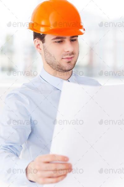 Examining a blueprint.