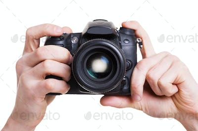 Digital camera. Close-up of man holding digital camera while isolated on white