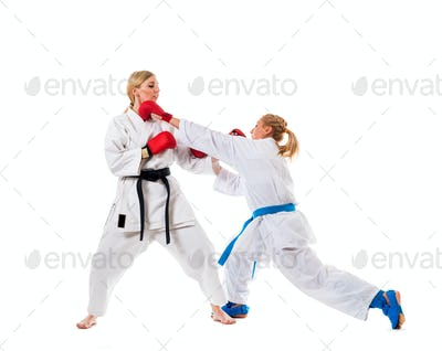Boxing training two young women on white