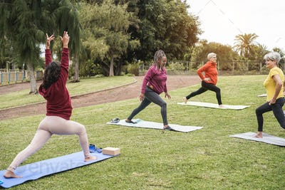 Happy people doing yoga class at city park - Focus on african woman face