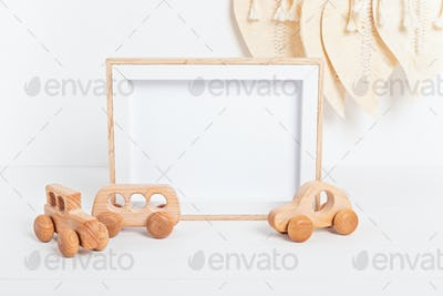Eco fiendly child wooden toys and mockup frame in baby room interior
