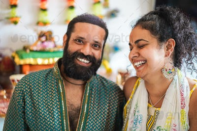 Indian husband and wife smiling in front of the camera - Focus on woman face
