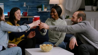 Afro american woman socialising with friends while having fun