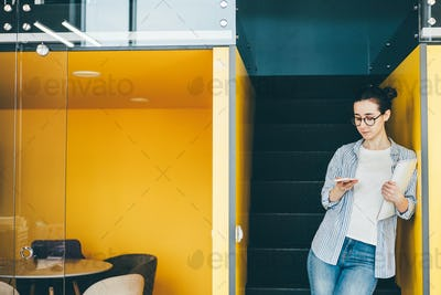 Young businesswoman using a smartphone in office