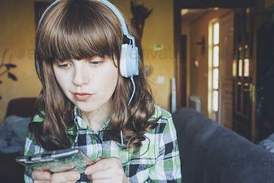 Young woman at home enjoying music