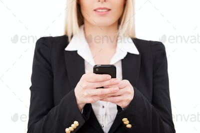 Businesswoman typing a message.