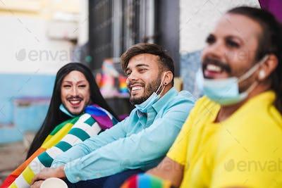 Group of gay men enjoying the LGBT parade while wearing surgical face masks