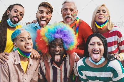 Multiracial people having fun at gay pride parade - Homosexual love and lgbt concept