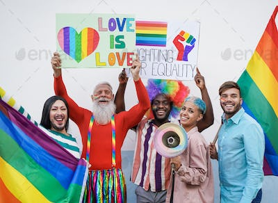 Happy multiracial and different generation people at gay pride parade with banner
