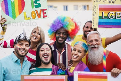 Cheerful multiracial people at gay pride event with banner