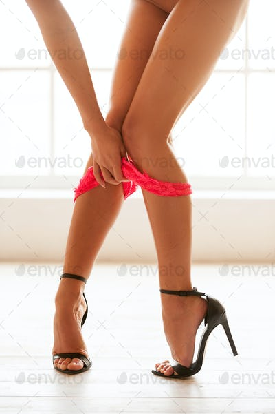 Taking her panties off.