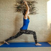 Woman doing yoga at home. Wellness concept.