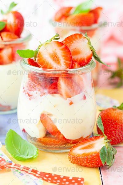 Cream dessert with fresh strawberries