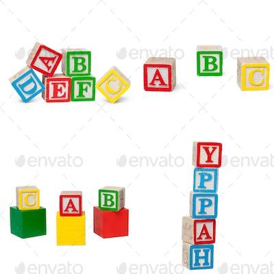 Wooden alphabet blocks isolated on white background. High quality photo