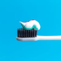 Toothbrush and toothpaste on blue. creative photo