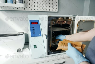 Professional disinfection of manicure tools in autoclave
