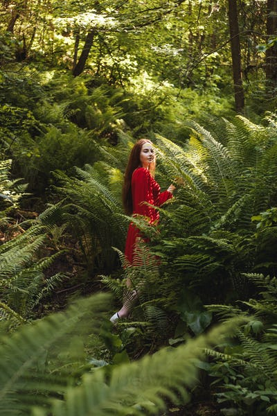 The young woman in fern forest.