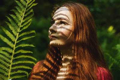 The young woman with fern leaf.