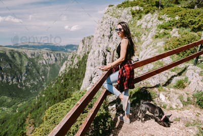 attractive woman relax in mountains with amazing view