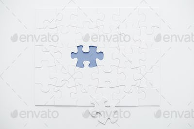The last one element. Top view of puzzle with the last one element laying near it