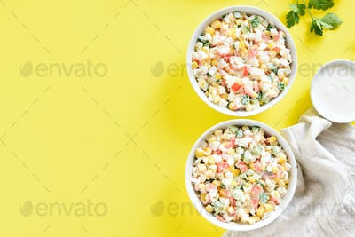 Salad with crab sticks, corn, eggs, cucumber and rice