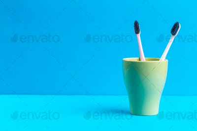 Toothbrushes in glass on the table. creative photo
