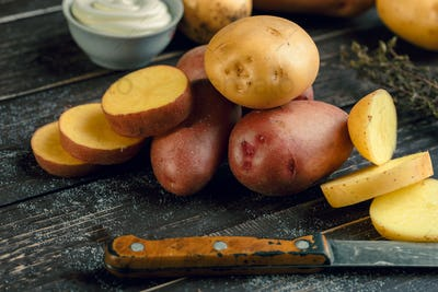 Fresh potatoes on the wood background. creative photo
