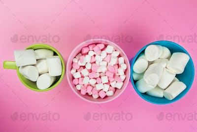 Marshmallows on pink background. close up. creative photo