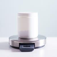 Protein powder jar on scales