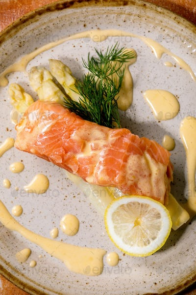 Cooked salmon fish on homemade ceramic plate