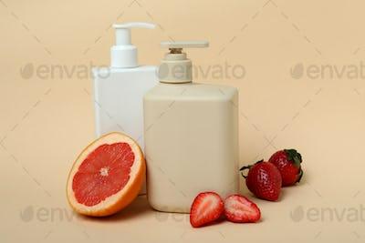 Natural shower gel and ingredients on beige background