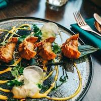 Gyoza crispy golden color set on plate.