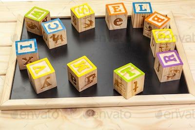 Wooden Alphabet Blocks close up. creative photo.