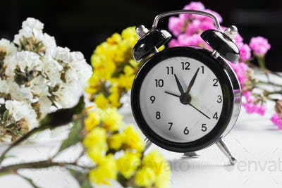 Spring Time Change Background with alarm clock and flower branches
