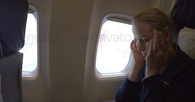 Woman in the plane feeling sick