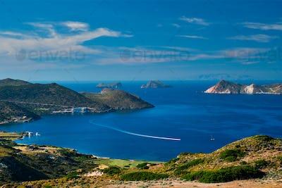 Aegean sea near Milos island with speeding speed boat catamaran ferry vessel in Greece