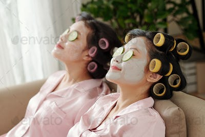 Women relaxing with moisturizing masks on