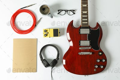 Flat lay composition with music accessories on white background