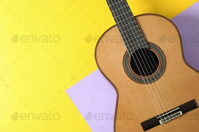 Beautiful classic guitar on two tone background, space for text
