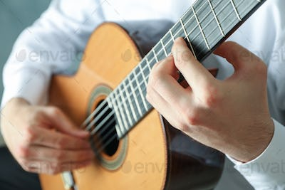 Man playing on classic guitar, space for text